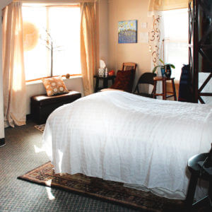 Picture of the interior office of Satori Massage in Ferndale, WA with a massage bed.